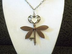 Dragonfly Key to my Heart by KimsHandmadePretties on Etsy, $20.00.  This key has a heart and a bronze dragonfly on each side of it. the necklace is 21 inches long with a lobster clasp in the back. This beautiful dragonfly Key charm is 3 inches long and 2 1/2 inches across the top wings. In The Game of Thrones Sansa Stark wears dragonflies as a symbol of her belief in true love.
