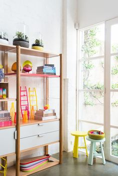 Shelving unit by Jardan, glass bonsai by Amanda Dziedzic, terrariums by Miniscapes, timber serving platters by Treehorn Design. Photo -Brooke Holm.