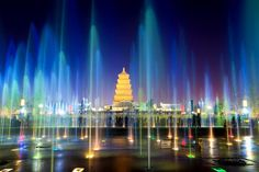 Fountains frame the Big Wild Goose Pagoda at night in Xi'an, China