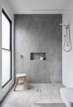 Walk-in, frameless glass, large format tile, rail shower