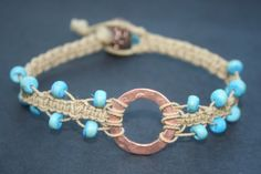 simple macrame bracelet with copper and coconut beads!