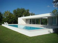 CASA EN OPEN DOOR: Casas de estilo moderno por MENEGHETTI ARQUITECTOS