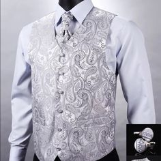 Silver Silk Vest, Handmade Silk Paisley Silver Gray Design for Weddings or Formal Events.  V Neck.  Men or Unisex 100%Silk Waistcoat Vest with Pocket Square, Cufflinks, and Cravat Set for Suit Tuxedo.  Read size chart.  This is a L.  Comment for other sizes and colors.  Also available in wine red and black.  This is new retail that is still in a sealed package. time2livelife Jackets & Coats Vests