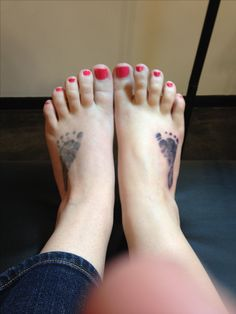 Both my girls baby foot print tattooed on my feet