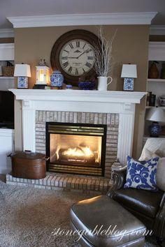 Lrge clock over fireplace