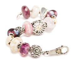 15-914- Trollbeads Mother's Day Bracelet - 334263-80201-Trollbeads Ruby;  332226-80002-Trollbeads Rose Quartz, Round;  288873-41816-Trollbeads Daisy;  333052-11450-Trollbeads Double Heart;  205931-11106-TROLLBEADS-Hydrangea;  334246-21160-Trollbeads Gold Mountain Flower;  228633-21310-Trollbeads Heart;  334252-61442-Trollbeads Cream Armadillo;  334248-61438-Trollbeads Nougat Flower;  332216-61386 Trollbeads Pink Desert;  332273-60194 Trollbeads Purple Prism;  269025-61334-Trollbeads Purple…