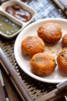 Aloo Paneer Kofta -- Indian fried potato dumplings, filled with golden raisins. Substitute Mexican queso blanco for the paneer cheese if necessary.