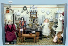Doll Kitchen c.1890 - 1.15 m wide, 76 cm high, 62 cm deep, 2 rear windows without panes, old wallpaper and floor paper, furnished with table, chairs, shelves.  Many accessories including butter machine, glass, porcelain, brass, copper, basket, ceramics.  Doll stove, around 1900, 34 cm wide, brass doors, water vessel, pan, kettle, pot, kettle for cocoa, impressive size.  From a German toy auction site.