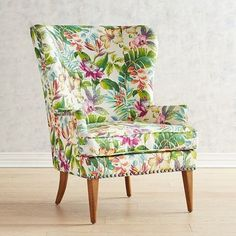 A graceful wing chair in search of a cozy corner, our hand-upholstered Asher is all about classic lines, capped midcentury modern legs and a beautiful, bright printed velvet. Why not invite a small table to hold tea and books?