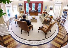 President Barack Obama reads briefing material before the Presidential Daily Briefing in t...