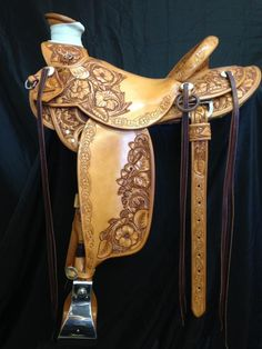Frecker's Western Saddles-Oak leaf, dogwood and prairie rose tooling with swivel knife border made by David Rigby