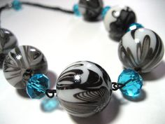 Hey, I found this really awesome Etsy listing at http://www.etsy.com/listing/93444707/chunky-black-lace-and-aqua-necklace