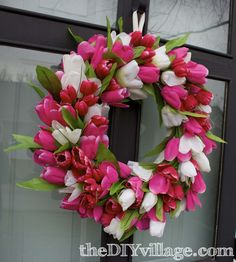 5-Tulip Door Wreath Tutorial - your ribbon is wrapped tightly enough there is no need to wire them in, the tulips will stay in place perfectly.
