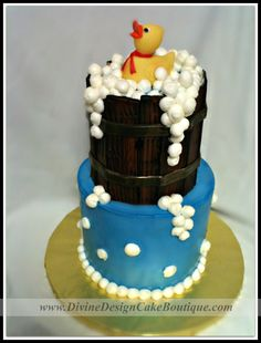 """Cute little bathing duck. Bottom cake is covered in butter cream. Top cake is covered and hand painted, fresh fondant """"wooden barrel""""."""