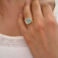 This stunning ring features a large square aqua chalcedony stone in a modern cushion cut. Framed in a brushed finish bezel. Metal: gold vermeil Gem: x chalcedony Band: square band / brushed finish I Love Jewelry, Jewelry Shop, Jewelry Rings, Silver Jewelry, Jewelry Accessories, Jewlery, Fashion Jewelry, Fashion Rings, Gold Rings