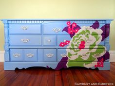 DIY Tutorial - Painting Furniture - You will not believe the before after seeing this beauty.  She used an overhead projector for the flower.