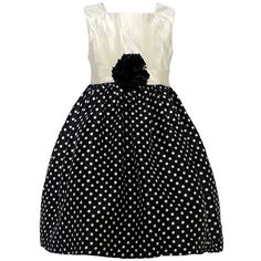 Trendy dress with a fitted bodice and a flared voluminous skirt from designer Mia Juliana. The dress has a sleeveless ivory bodice and a black ivory polka dotted skirt. A cute fabric flower adorns the waist. Zips up at the back. Crinoline lining is firm a