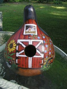 Red Barn Gourd was wood burned and painted with acrylics