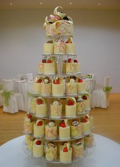 Mini Cheesecake Wedding Cake.....if you wanted rustic wedding version of this you could do the cheesecakes in mini mason jars