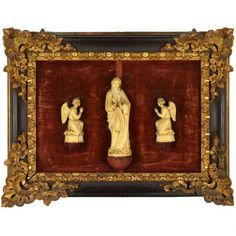 Continental Baroque Ivory Group 18th/19th Century  Of a standing figure of Mary flanked by a pair of kneeling angels, framed. Height of Mary 7 3/4 inches (19.7 cm).