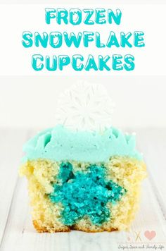 Disney FROZEN fans will love FROZEN Snowflake Cupcakes. Each vanilla cupcake with blue colored vanilla buttercream frosting has a hidden surprise inside blue velvet snowflake baked inside. These FROZEN cupcakes are perfect for a FROZEN birthday party dessert. - FROZEN Hidden Snowflake Cupcakes Recipe on Sugar, Spice and Family Life