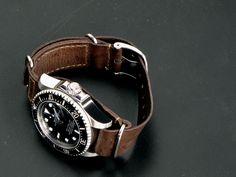 a Rolex Sub on a Leather Nato strap