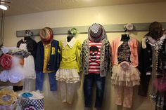 Adorable way to display outfits in a retail store.  Such cute clothes for kids.
