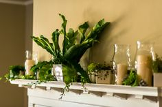 Organic Greens Mantle Decor. Wedding Planning & Design by Simply Wed  www.simplywed.com