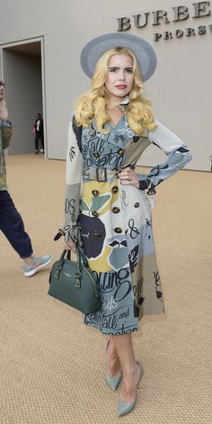 British singer Paloma Faith wearing a hand-painted Burberry Trench Coat and Burberry Orchard bag at the Prorsum S/S15 Show