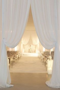Draping the doorway makes the entrance spectacular ~ https://www.insideweddings.com/weddings/modern-purple-blue-white-wedding-at-contemporary-chicago-venue/541/