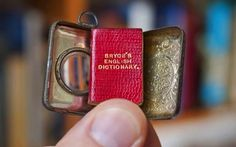 The Smallest English Dictionary in the World has been discovered by West Country book shop owner Graham York. Although only 1x3/4inch the tiny book's 384 pages contain thousands of words, and even comes with a lens in its case for surreptitious study when challenged by a lack of diction.