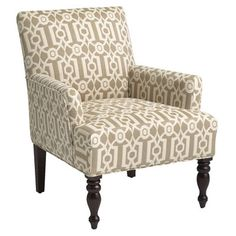 Our popular Liliana silhouette is now covered in ironwork—or at least, a distinctive graphic ironwork pattern. Underneath, it's the same classic, comfy chair you've come to love, with slim, flared arms, a deep cushioned seat, self-welting and turned hardwood front legs. Better strike while the ironwork's hot.