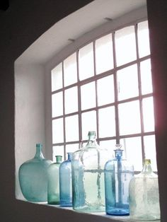 Great idea for displaying aqua and blue jars, bottles or vases.  Let the sun catch the colors!