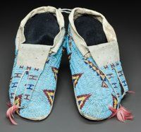 A PAIR OF SIOUX BEADED HIDE MOCCASINS c. 1890