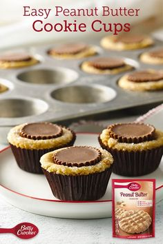 Easy Peanut Butter Cookie Cups This easy peanut butter cookie will triple your pleasure with peanuts, peanut butter chips and peanut butter cups all together in one cookie cup. Perfect for your holiday cookie exchange. Cake Mix Cookie Recipes, Candy Recipes, Baking Recipes, Brownie Cookie Cups, Yummy Recipes, Recipies, Peanut Recipes, Cookie Swap, Cookie Bars