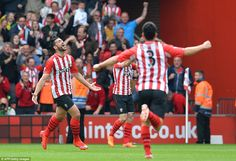 Pelle celebrates wildly after his bullet header gave the Saints the lead for the second ti...