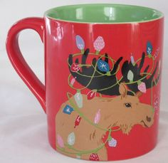 "Hatley Christmas Coffee Mug: Reads, ""Moose Lighten Up"" on the back and depicts a moose tangled up in a string of Christmas lights. Makes me smile."