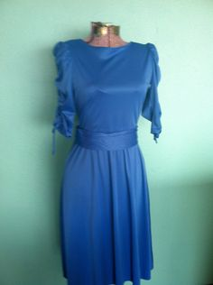 VINTAGE WOMENS DRESS - Royal Blue 1980s dress with ruching sleeves and criss cross back by HUXEN on Etsy https://www.etsy.com/listing/114362078/vintage-womens-dress-royal-blue-1980s