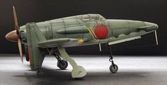 J7W1 Shinden by Steve Martin (Hasegawa 1/48).  One of the last warplanes of the Rising Sun, the Kyushu J7W1 Shinden (Magnificent Lightning) was basically ordered straight off the drawing board by the Imperial Japanese Navy in its desperate search for a high performance interceptor. The J7W1 was one of the few canard (tail-first) airplanes to be developed during WWII.