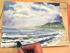 step-by-step art tutorial: How to paint a stormy seascape in watercolor! Complete directions and photos explain each step of the painting process!