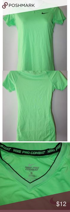 """Womens Nike Pro Combat Athletic Shirt Workout Womens Nike Pro Combat Athletic Shirt XS Green Fitted Dri Fit Short Sleeve b24 Preowned in good condition No rips, tears or stains Bright green with black trim Nike Pro Combat Dri-Fit Length from shoulder to hem is 26"""" Chest from under arm to under arm is 17"""" Minimal wear Thank you for looking! Nike Tops Tees - Short Sleeve"""