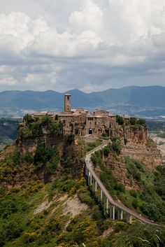 Civita di Bagnoregio in Italy | Stunning Places #Places Civita di Bagnoregio is a town in the Province of Viterbo in Central Italy, a frazione of the comune of Bagnoregio. It is about 145 km north of Rome.