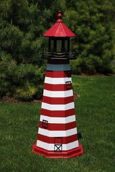 """4 Foot Wooden West Quoddy Painted Wooden Lighthouse by Lighthouse Man. $202.80. """"West Quoddy Wooden Lighthouse  Each one of our wooden Lawn lighthouse ornaments is meticulously handcrafted from a marine signboard plywood. Making it much more impervious to the elements then other wooden lighthouses on the market. Our painted wooden lighthouses feature decorative plastic molded windows and doors. Every yard & garden lighthouse is completely hand-painted. We specialize..."""
