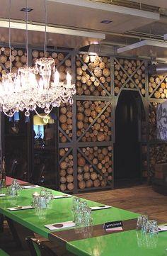 Fabbrica Rotterdam - italian restaurant  Tjep.............stacked wood pile walls......
