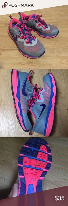 Nike tennis shoes! Nice pink and blue Nike tennis shoes, has been worn few times, but then my feet grew, very fun, comfortable but not formed to my feet yet! Dual fusion running shoes, great for trail running! Nike Shoes Athletic Shoes