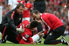 Jesse Lingard of Manchester United receives treatment