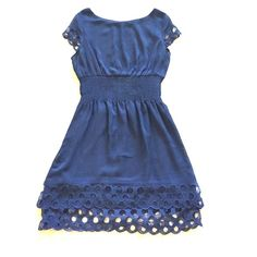 Navy bar III dress So adorable. Detailed cap sleeves, double Ruffled bottom, stretchy waist, light and flowy. Size large but runs a little small, I think it would also fit a medium. Bar III Dresses