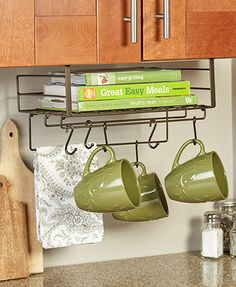 Eliminate clutter and add extra organization to your kitchen with this Under Cabinet Storage Shelf. It slides onto the bottom edge of cabinets, cupboards or pan
