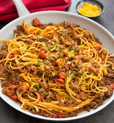 One Pot Taco Spaghetti This taco spaghetti couldn't be any easier. Everything is prepared in one pot for very little clean-up and your meal is ready in about 30 minutes. Growing up, I always looked forward to taco night. My mom would b Taco Spaghetti, Mexican Spaghetti, Spaghetti Squash, Spaghetti Ground Beef, Angel Hair Spaghetti, Mexican Pasta, Spaghetti Casserole, Casserole Recipes, Pasta Recipes