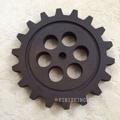 This gear is made of wood and hand finished to look like iron. Measures 12 inches in diameter and is .75 inches thick.  These will look great adorning your wall as a unique decor item. Looks great in a collage of multiple gears. Perfect Christmas and Holiday present for that hard to shop for man in your life.  _________________________________________________________  **OTHER GEAR STYLES/SIZES & PRODUCTS**  To view other gear sizes and styles please visit our shop at…